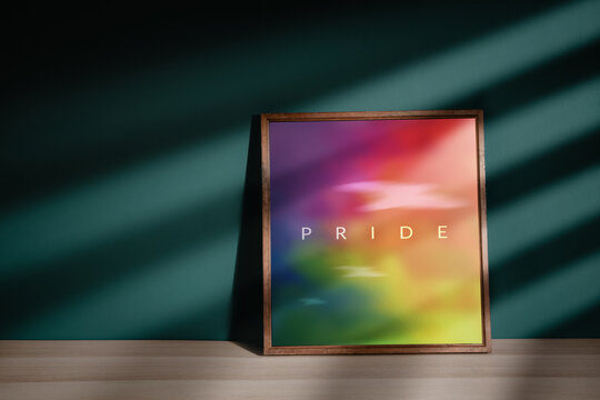 Gay, Homosexual, LGBTQI Concept. Rainbow Color picture with Pride Text in Photo Lying on the Floor in House