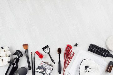 Black beauty products, accessories for makeup, manicure - brushes, sponges, buds, pads, towel, red...