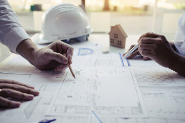 Engineers are helping to design work on blueprints and collaborate on structural analyzing of...