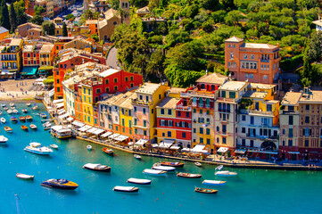 Fototapeta It's Aerial view of Portofino, an Italian fishing village, Genoa province, Italy. A vacation resort with a picturesque harbour and with celebrity and artistic visitors.