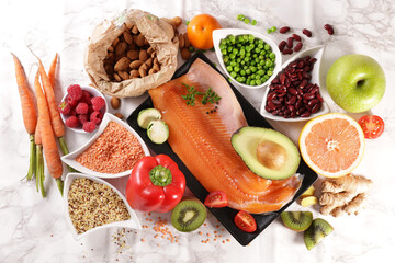 fruit, vegetable, fish, nut, cereal- balanced diet food background