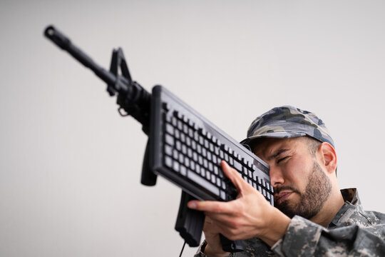 Social Cyber Warfare. Army Soldier Using Keyboard