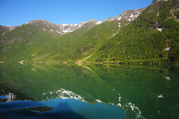 Beautiful calm Norwegian fjord and mountain landscape of the Sognefjord or Sognefjorden, Vestland county in Western Norway.