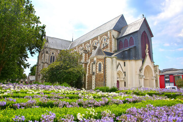 View of the Saint-Nazaire Church in beautiful bluebell gardens, and with interesting post-war stained glass, Saint Nazaire, Loire-Atlantique, Brittany, France.