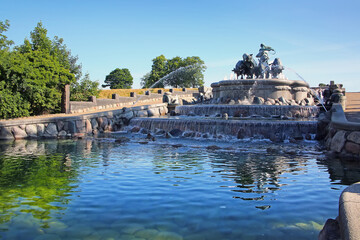 The Gefion Fountain with a group of animal figures being driven by the Norse goddess Gefjon on the harbour front, Nordre Toldbod in Copenhagen, Denmark.
