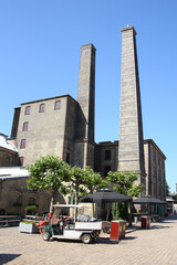 Towers or chimneys and the factory of an old historic brewery, Copenhagen, Denmark.