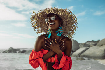 Acrylic Prints Akt Beautiful african woman enjoying on the beach
