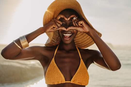 African woman on beach holiday