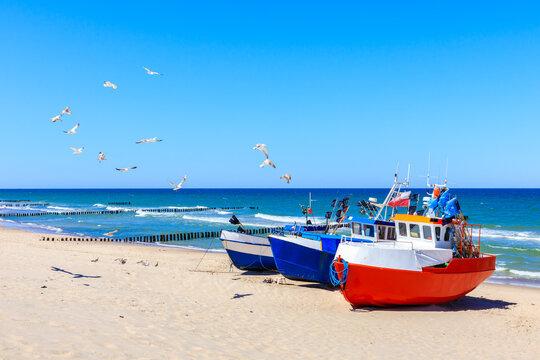 Fishing boats on sandy beach in Chlopy village port, Baltic Sea coast, Poland