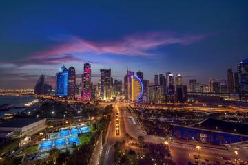 Fototapeta Beautiful Sky line view of after sunset. West bay Financial Hub of Doha City