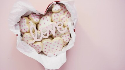 Wall Mural - Flat lay. Heart shaped sugar cookies decorated with royal icing in gift box.