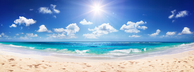 Idyllic Sand Beach With Sun Over Ocean