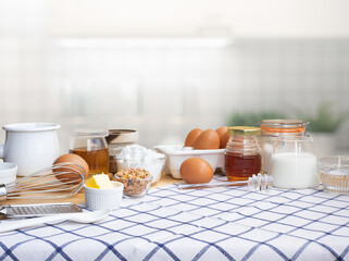 Selective focus.Cooking breakfast food or bakery with ingredient and copy space of tablecloth in kitchen room