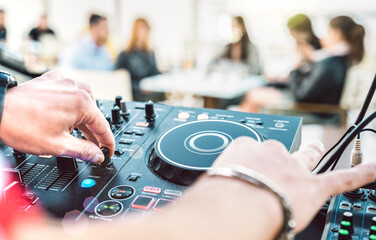 Closeup of dj playing on modern cd usb player at summer beach party - Happy hour and entertainment...