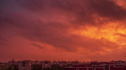Fotobehang - Beautiful epic dramatic storm red sunset sky clouds moving over city skyline. Timelapse, 4K UHD.
