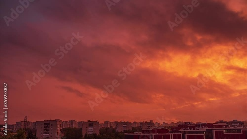 Fotobehang Beautiful epic dramatic storm red sunset sky clouds moving over city skyline. Timelapse, 4K UHD.