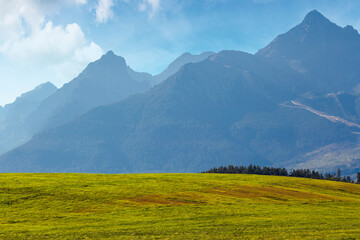 Wall Mural - countryside summer landscape. rural fields rolling in to the distant high tatra mountain ridge in slovakia. great scenery on a sunny day