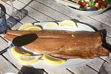 Fresh smoked salmon with lemon slices, typical Midsummer food