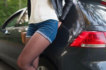 Fotobehang Ezel Female prostitute standing near the client's car.