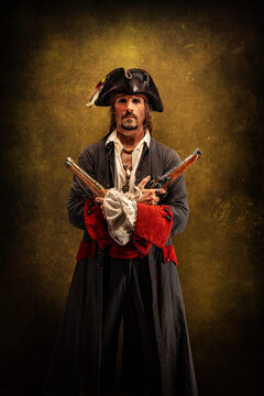 Portrait of a pirate, holding two musket pistol in his hands