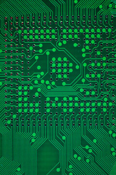 macro photo of green printed circuit board with BGA pads