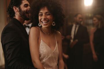 Cheerful couple dancing at gala night