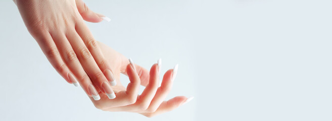 Delicate French manicure. French classic manicure. Wedding French manicure, Beauty elegant female hands with french manicure isolated on white