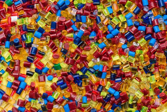 lot of colored plastic resin granulates