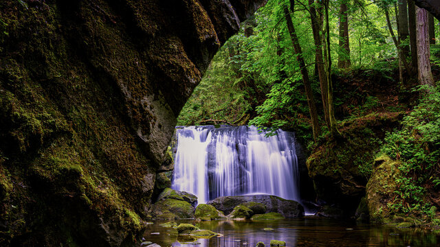 Old stone bridge and waterfall at Whatcom Falls in Bellingham Washington