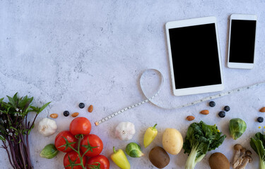 nutrition on mobile phone for diet food  and meal. flat lay of  healthy vegetable .