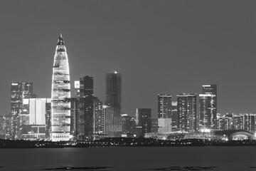 Fototapete - Skyline of Shenzhen city, China at night. Viewed from Hong Kong border