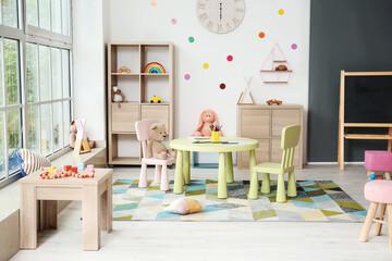 Stylish interior of modern playroom in kindergarten