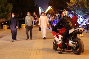 A Saudi youth rides his motorbike on Tahlia Street as nightlife kicks off, after the government loosened lockdown restrictions following the outbreak of the coronavirus disease (COVID-19), in Riyadh