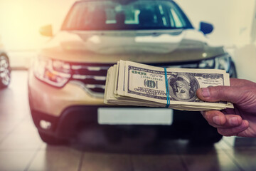 dealer make agreement to buy a new car, man holding dollar