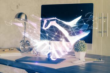 Desktop computer background in office and handshake hologram drawing. Double exposure. Pertnership...