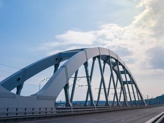Fotorolgordijn Bruggen Steel arch of the combined road and railroad bridge