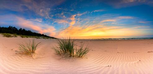 Beautiful summer sunset over beach at Baltic sea - panorama