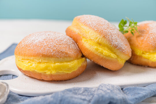 """Bolas de Berlim, or """"Berlin Balls"""". Portuguese fried dough with sugar, Filled with sweet egg cream."""