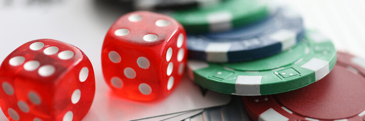 Close up on table are dice chips playing cards. Possibility relaxation, emotional relaxation in casino. Complex game combinations and tasks. Games develop logical thinking and memory