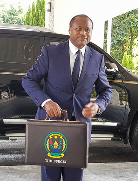 Rwandan Finance and Economic Planning Minister Uzziel Ndagijimana holds a briefcase containing the Government Budget documents for the 2020/21 fiscal year in Kigali