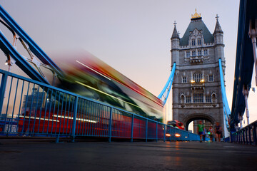 Poster London red bus Blur Red Bus Passing on London Tower Bridge Long Exposure Lower Angle