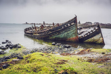 Garden Poster Shipwreck Sinking ships at the shore on Isle of Mull, Scotland.
