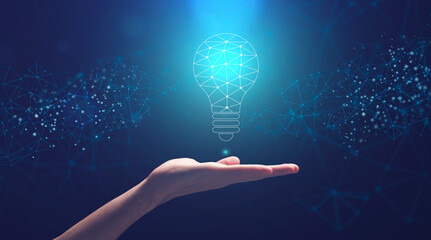 Creativity And Innovations. Male Hand Holding Abstract Lightbulb Made Of Polygonal Connections Wall mural