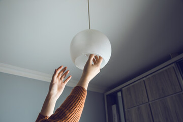 woman change bulbs