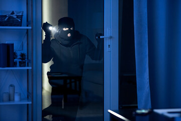 Criminal trying to break into apartment or office to steal - fototapety na wymiar