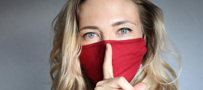 Stylish woman wearing cloth cotton face mask protect against coronavirus.  Reusable fashionable face mask.