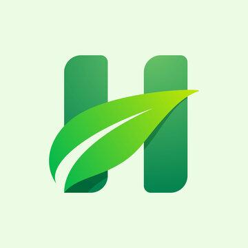 Ecology H letter logo with green leaf.