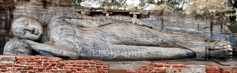 Sri Lanka travel and landmarks - ancient city of Polonnaruwa, UNESCO World Heritage Site. Buddha statue carved in the rock...