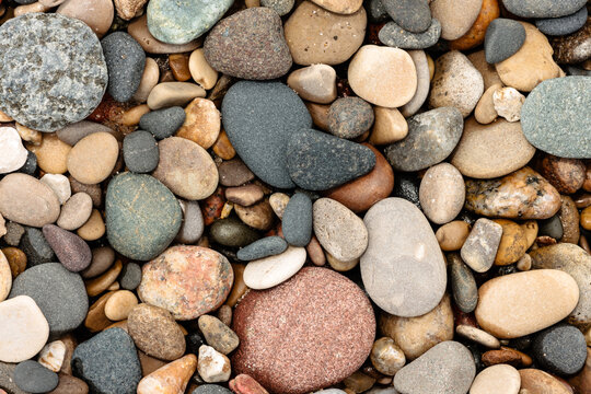 The many different stones deposted by Lake Michigan along the beach at Kohler Andrae State Park, Sheboygan, Wisconsin in early June