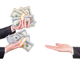Business woman hands in office suit with hundred dollar banknotes packages isolated on white background giving money to empty hand. Banking financial concept for loan, bribe, taxes, savings, profit